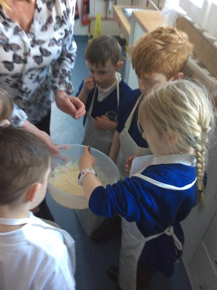 We helped Mrs Crowther to add the ingredients
