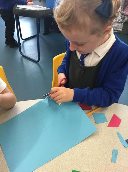 Practising scissor skills, cutting out 2D shapes