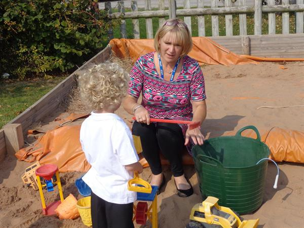 Having fun in the sand with Mrs Taylor