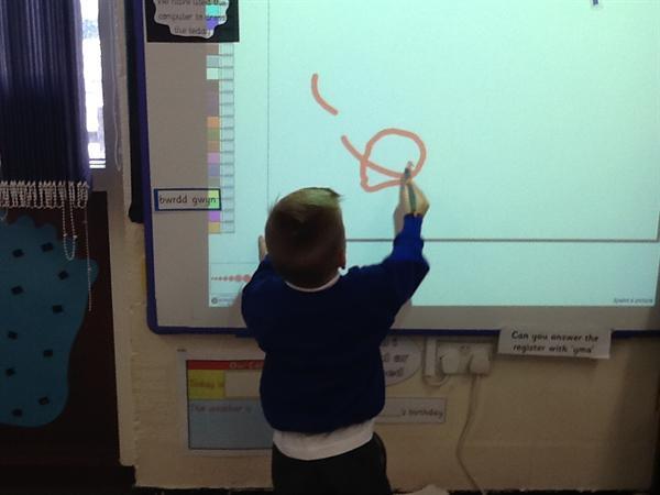 We enjoy mark making on the whiteboard.