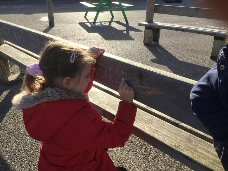 We went outside to practise writing our numbers