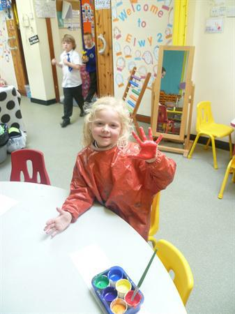 Amy having fun with colour mixing
