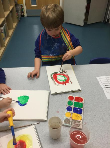 Carefully painting concentric circles.