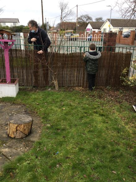 The new fence was secured in place with the help of the children