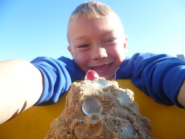 Lincoln enjoying building in the sand.