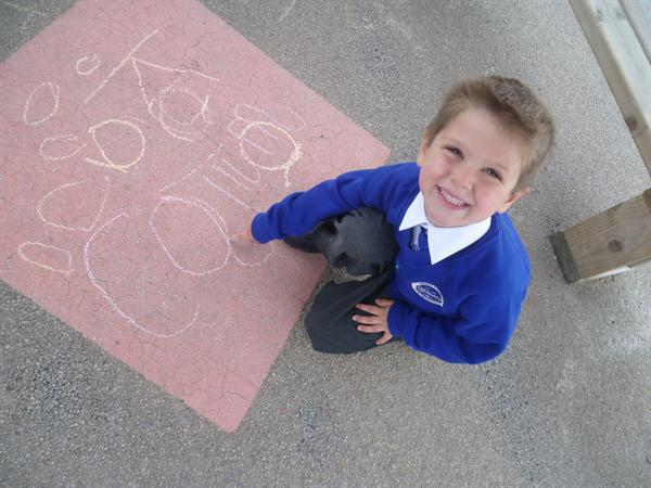 October - Callum writing his name in the outdoor c