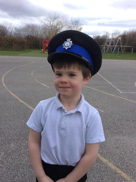 Trying on a real police hat was great fun