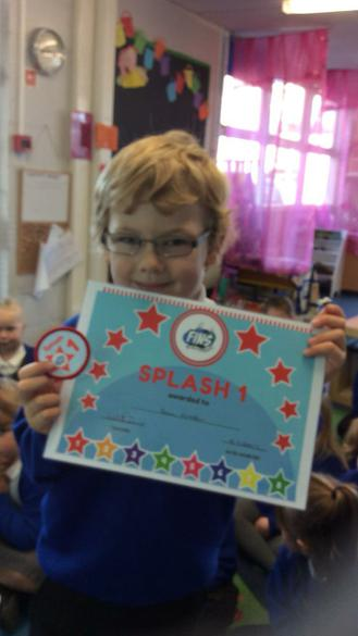 My friends are proud of my swimming certificate.