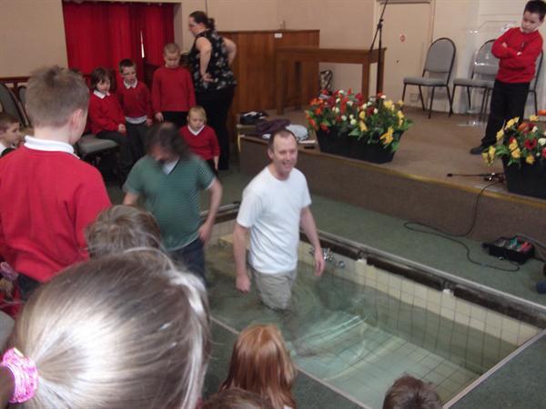 Rev Trevor Casey steps into the Baptism pool.