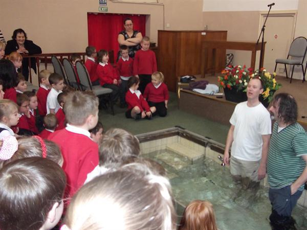 Rev Casey prepares for the mock Baptism.