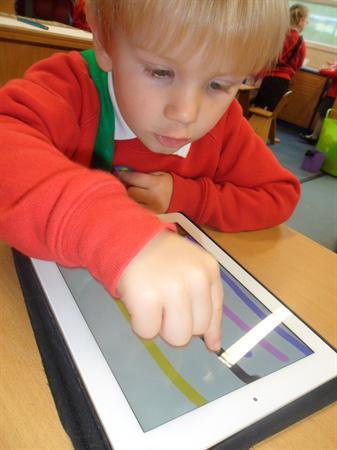 Using the Ipad to write numbers one and two.