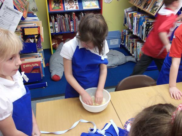 Preparing the mixture, no lumps please Maizie!