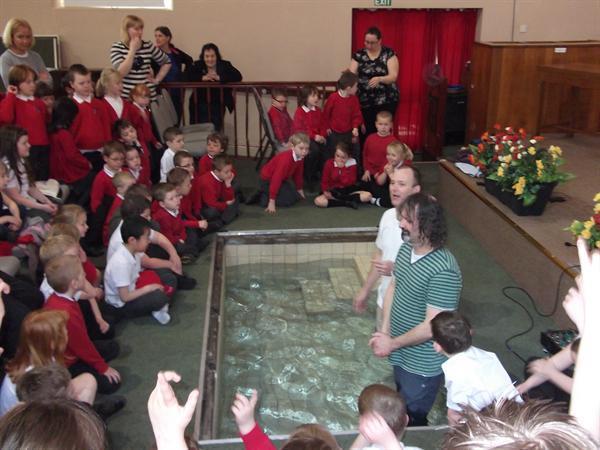 Rev Trevor Casey prepare to Baptise Mark.