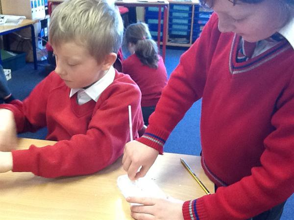 Cornflour mixed with water...solid or liquid?
