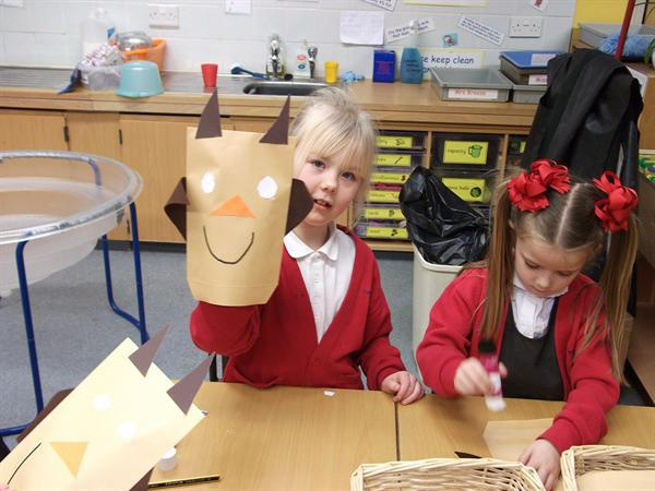 Making owl puppets.