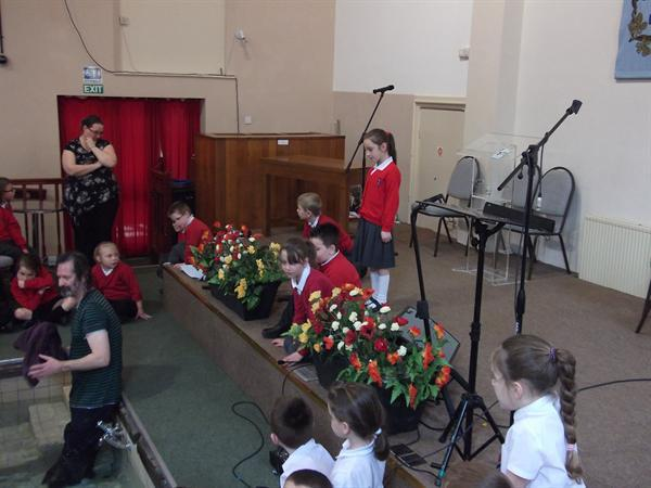 Some children watched from the stage.