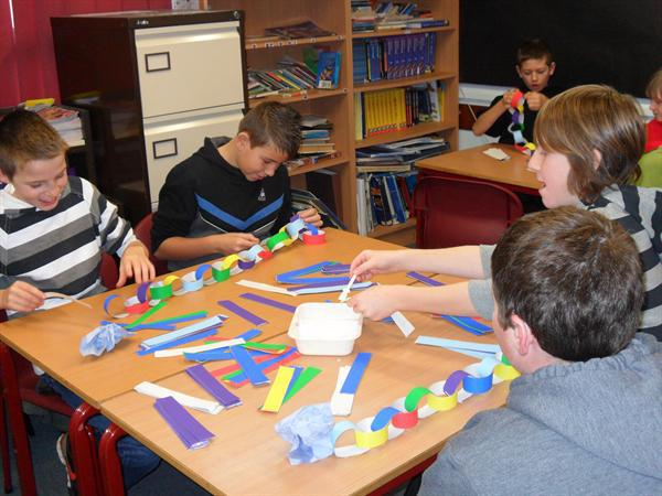 Busy pupils making paper chains