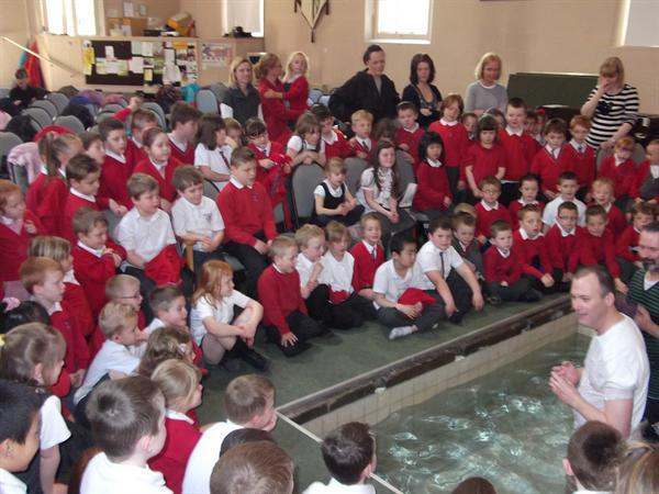 The children are listening well to Rev Casey.
